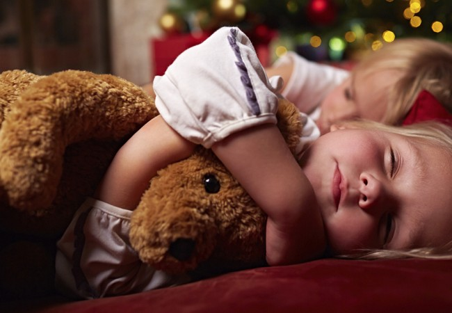 Two young children soundly asleep during the holidays