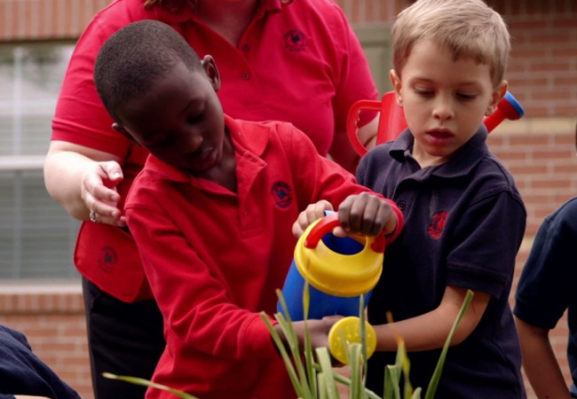 Primrose students water plants to encourage experiential learning