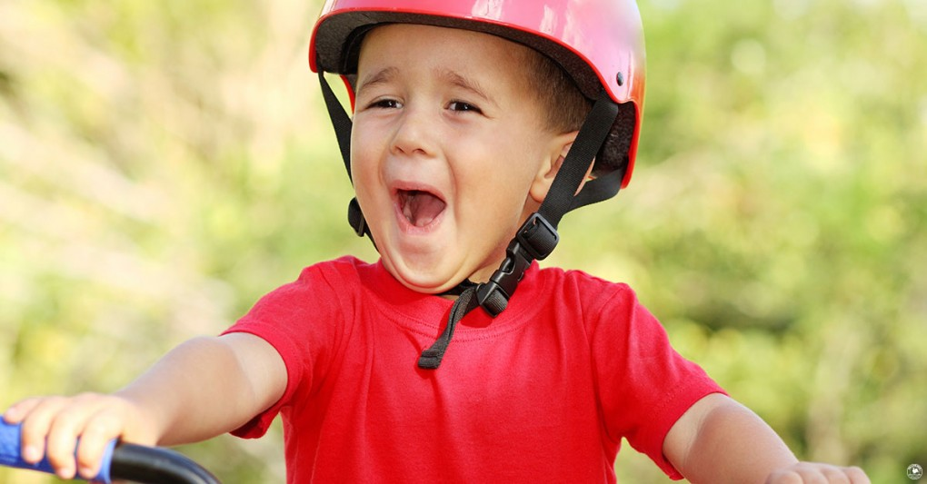 A nervous but excited little boy riding a bike