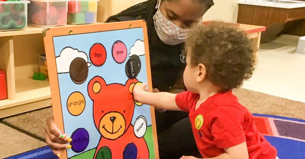 teacher with mask and toddler color matching