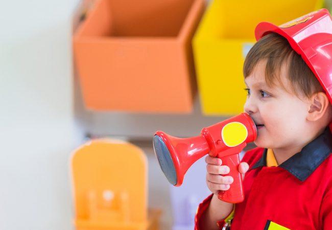 Preschooler dressed up as firefighter