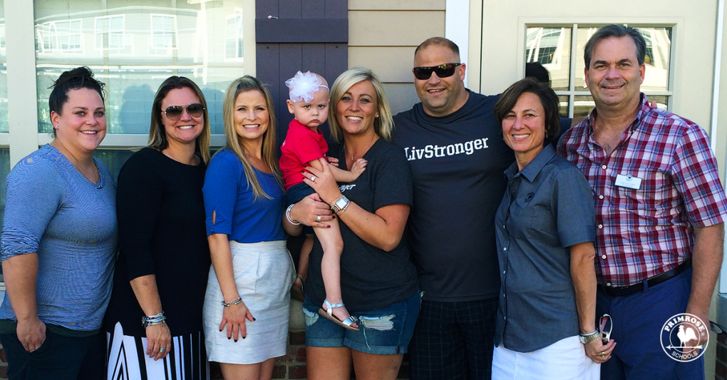 A group of Primrose parents and teachers with little Olivia, at a fundraiser for her leukemia treatment