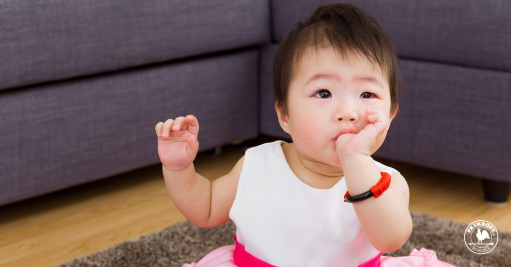 Little baby girl sucking her thumb