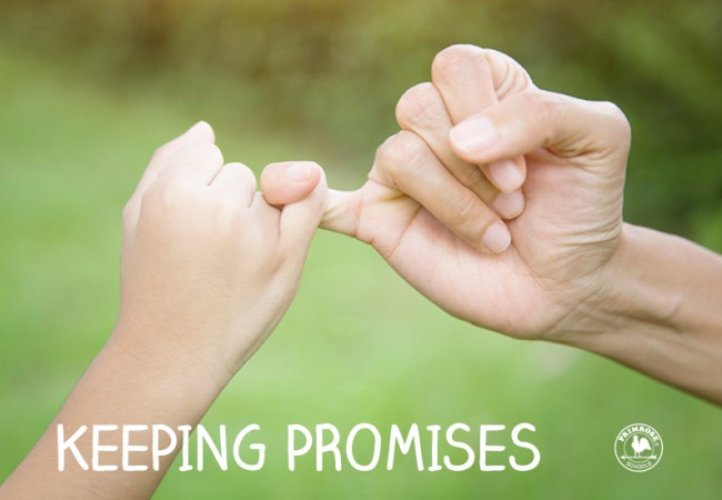 Mother and daughter entwine their little fingers to pinky swear