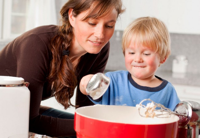 Mother involving her son while baking