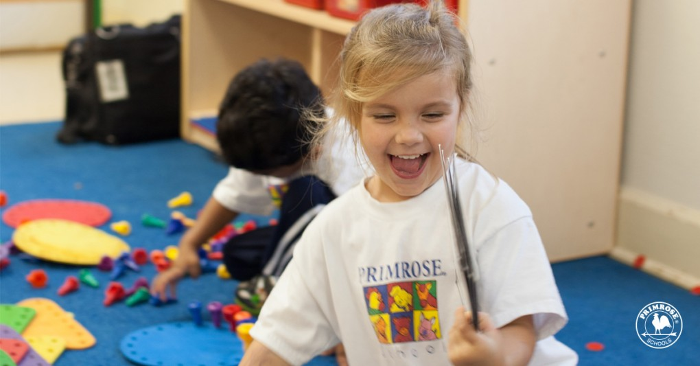 A Primrose student enjoying play time in the classroom