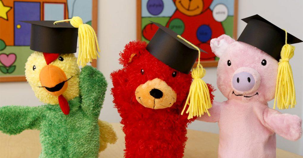Primrose puppets celebrating graduation with little graduation hats