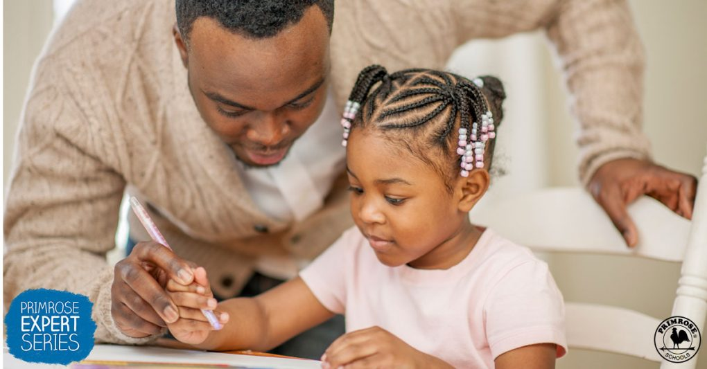 A father helps his daughter for her craft work