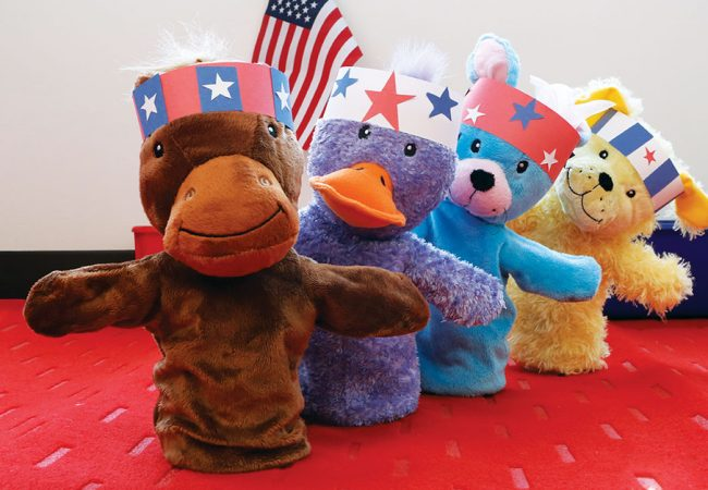Primrose puppets wearing patriotic headbands for fourth of July