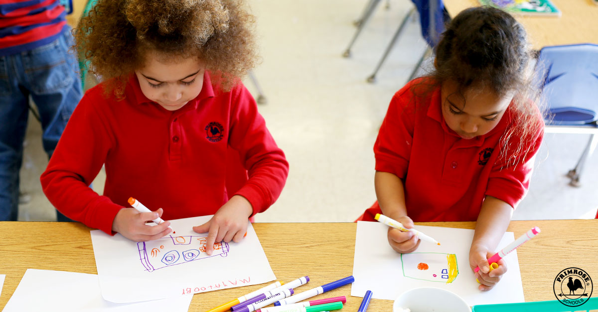 children coloring in Primrose uniforms
