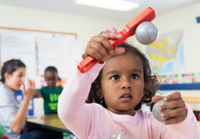 Primrose student learns about STEAM by playing with magnets in classroom