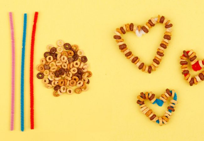 Heart-shaped bird feeders made with cereal and pipe cleaners