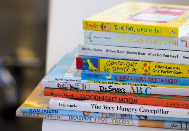 A stack of Primrose recommended books for summer reading