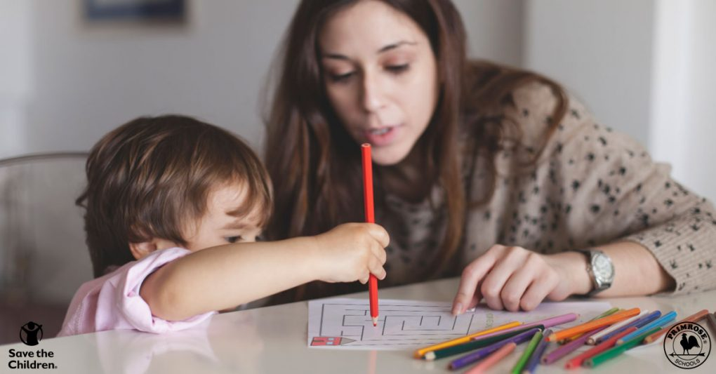 Mom helps her young child complete a printable safety activity