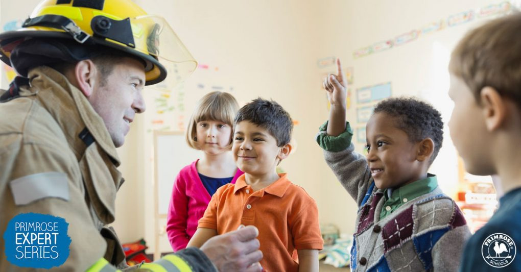 A firefighter interacts with a group of students