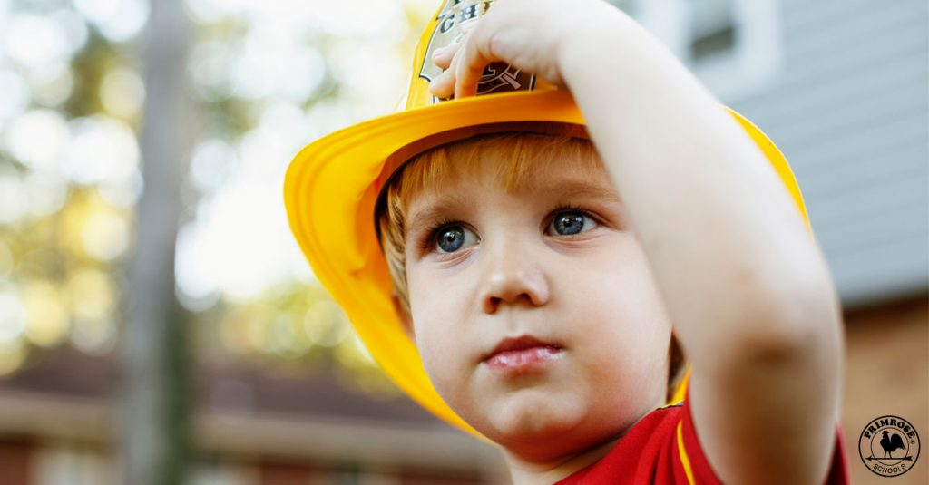 A boy with Fire Fighter cap