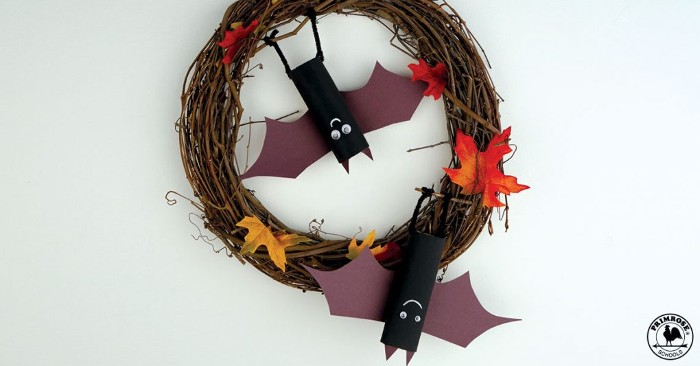 Wreath made from twigs and leaves with recycled toilet roll bats hanging from it
