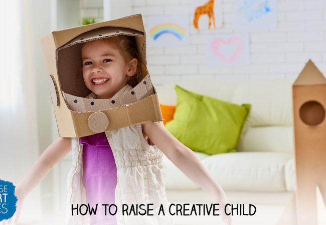 A happy young girl wearing an astronaut helmet made from cardboard