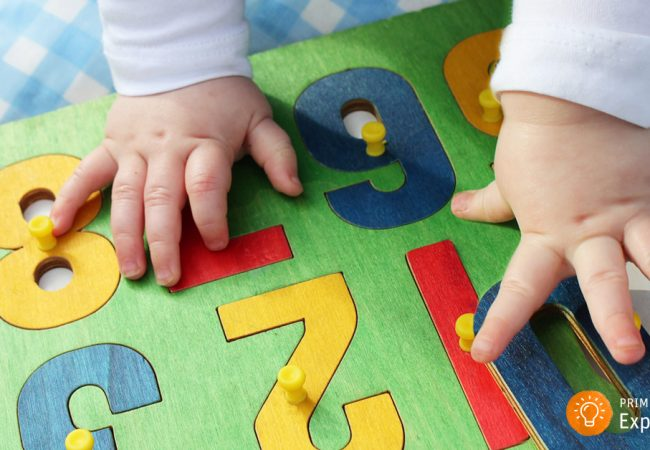 Infant playing with number puzzles