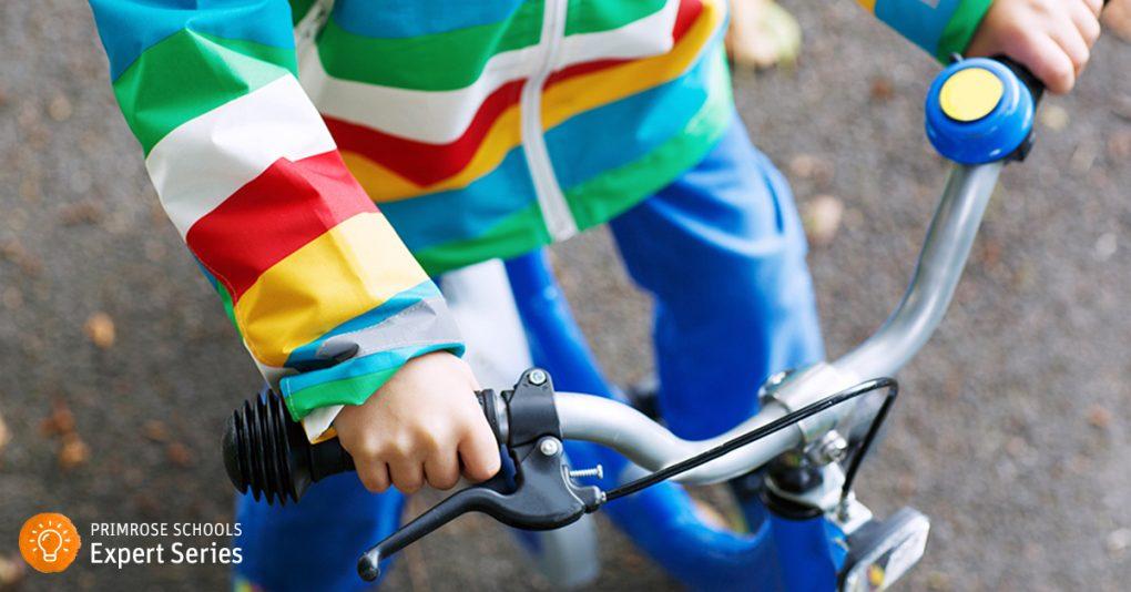 Child preparing to ride a bike