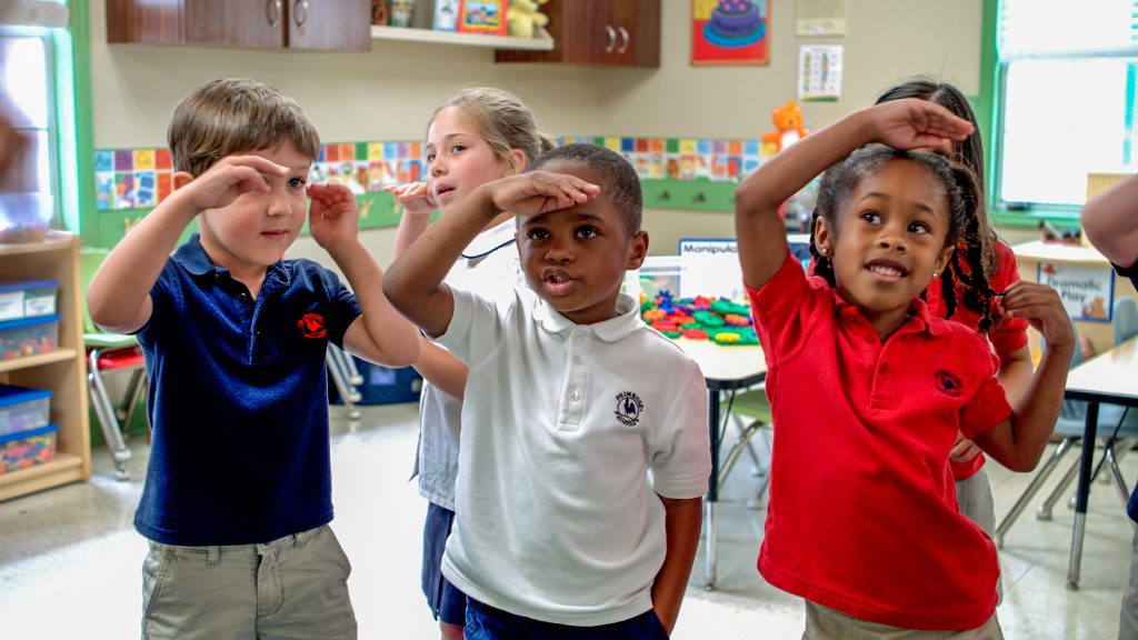 Kids dancing in sync to a song while practicing self-control