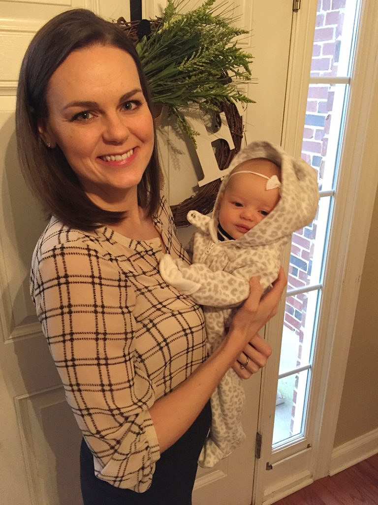 Mom holds her infant daughter on her first day at Primrose.