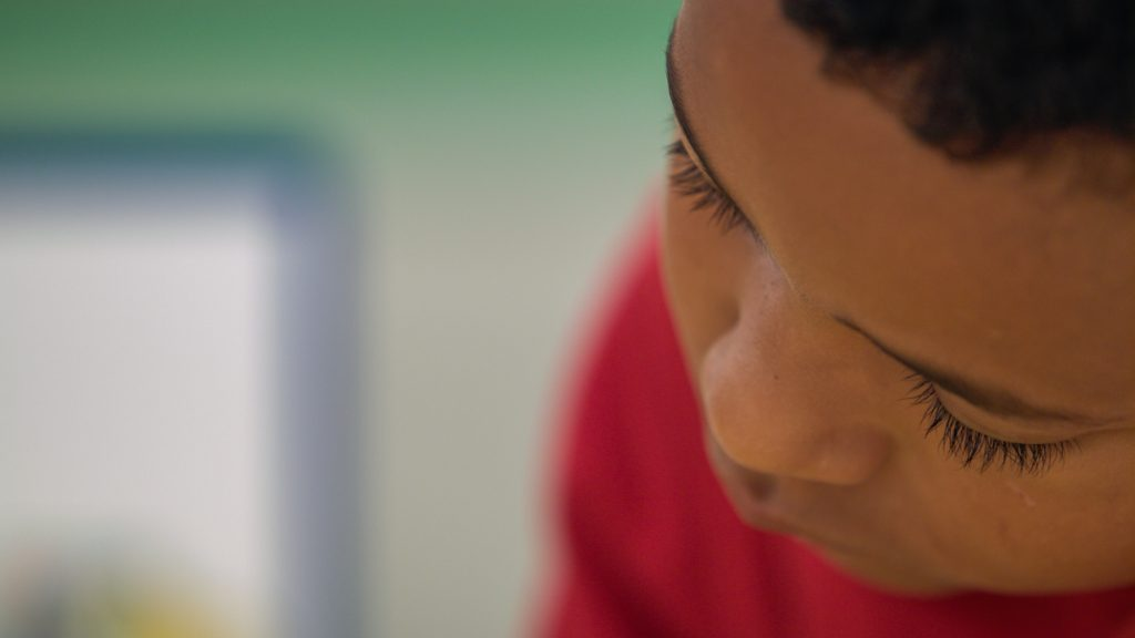 Close-up of young boy practicing critical thinking skills