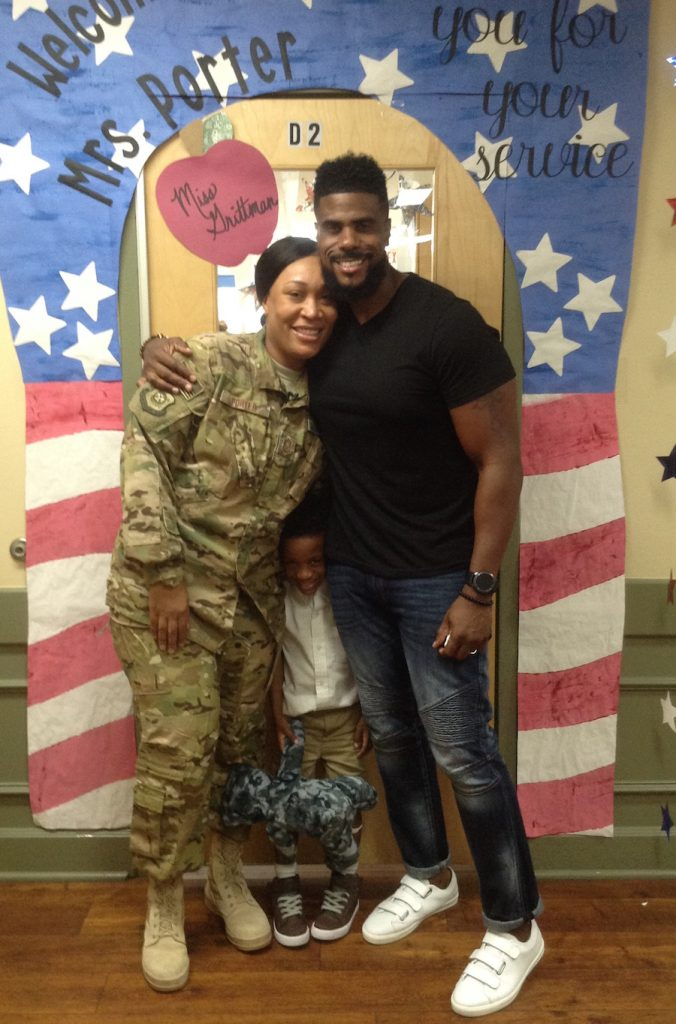 Military mom poses with son and husband after surprising son at Primrose.