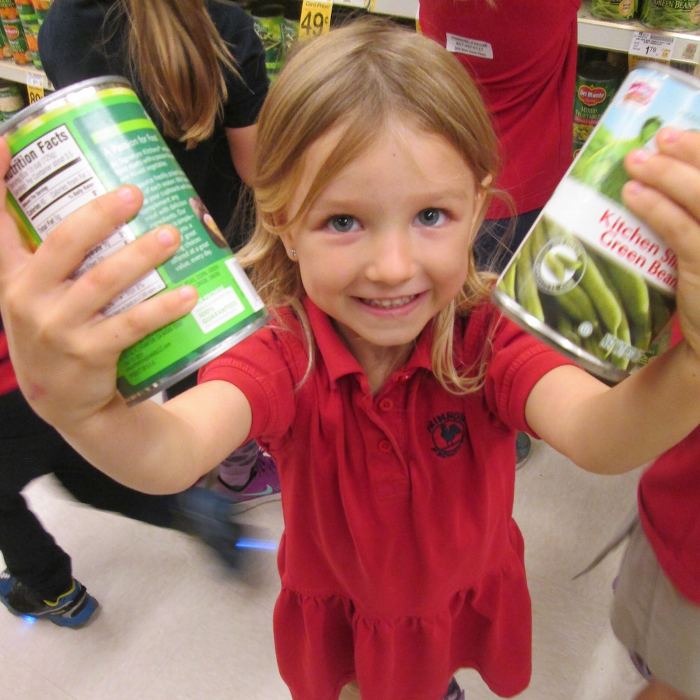Preschooler shops during a canned food drive