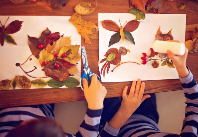 Two kids make thanksgiving arts and crafts