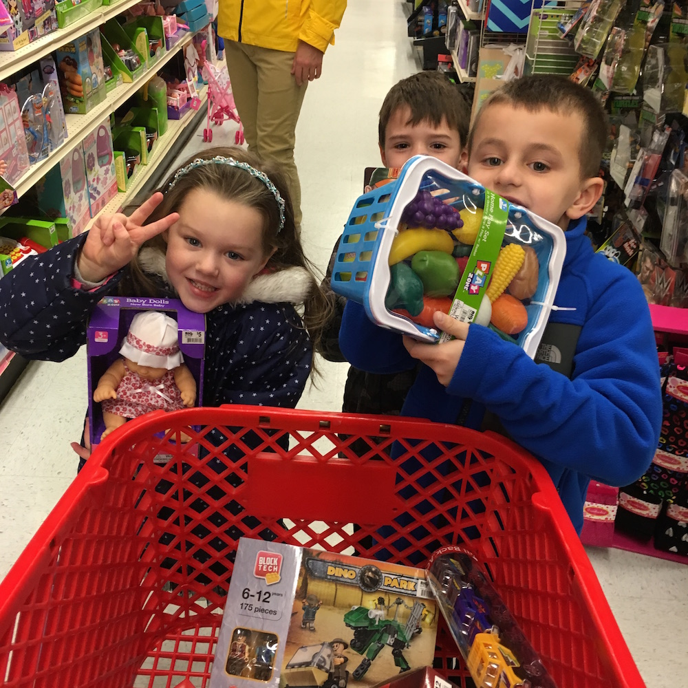 Students go shopping for holiday gifts for those in need.