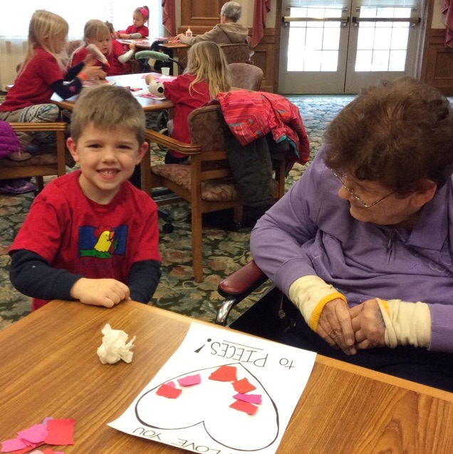 Primrose Student Makes Valentine's Cards with an Adopted Grandparent