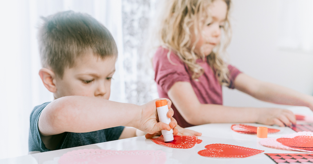 Two siblings make Valentine's Day cards together