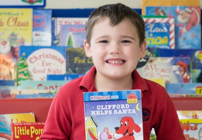 Preschooler Braxton shows off some of the books he's read