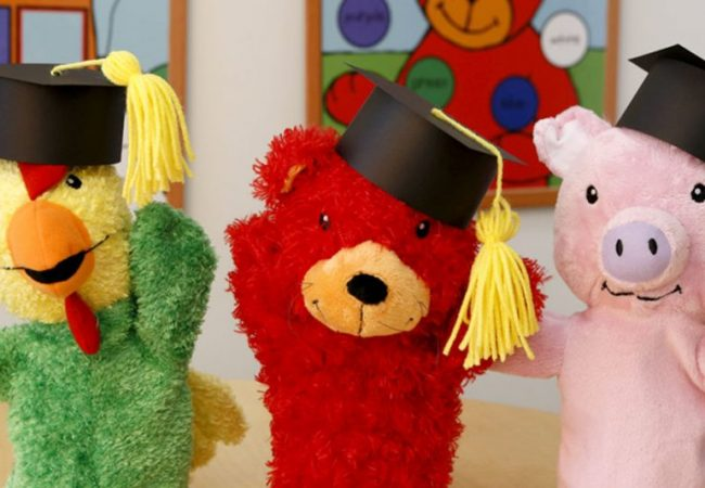 Three animal puppets wearing black graduation caps
