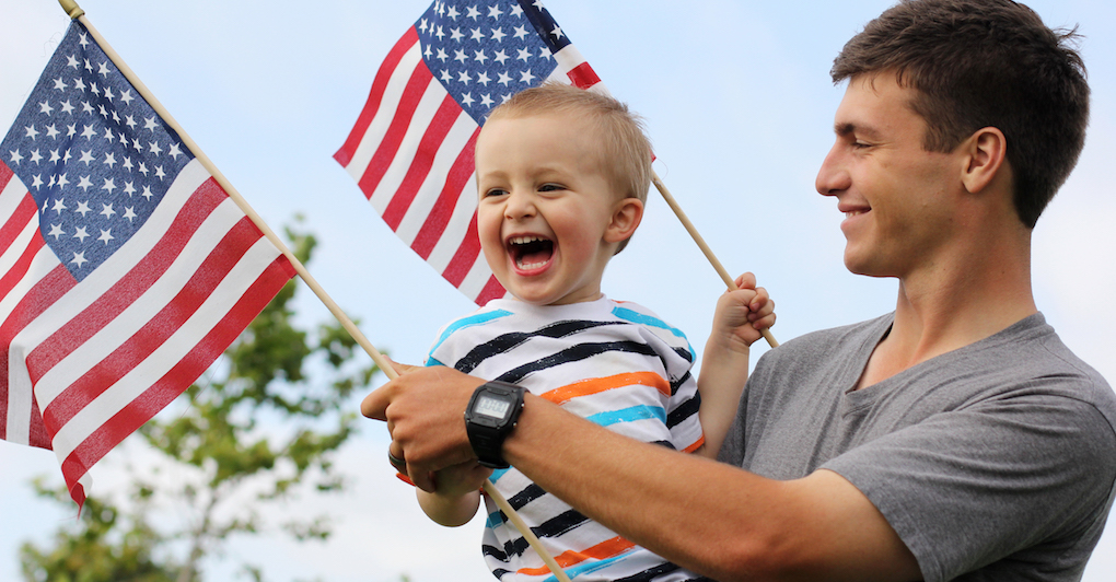 Father and son with American flags