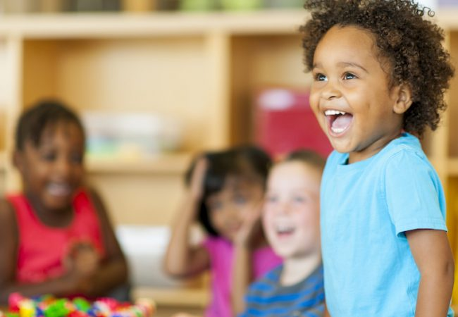 3-5 year old preschool children smile in classroom
