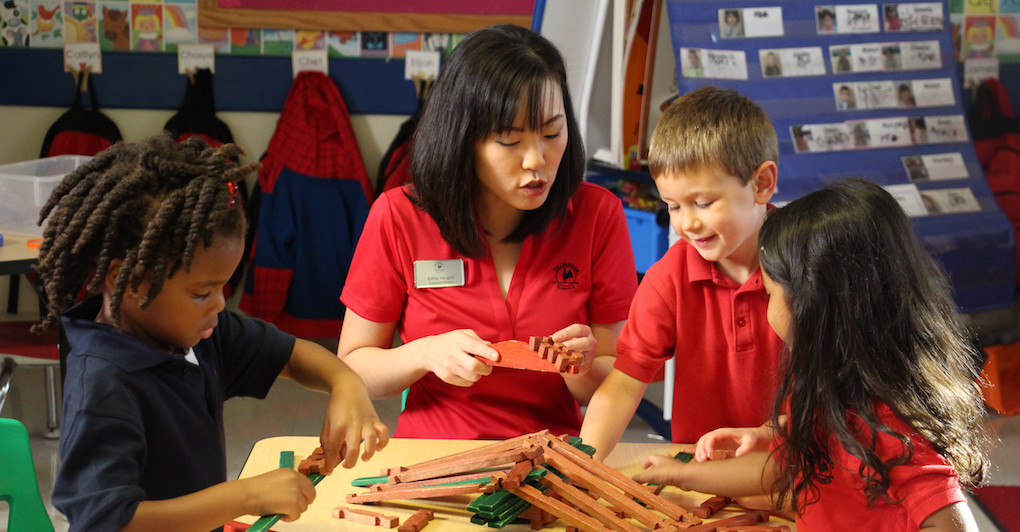 Primrose teacher helps preschool students build and play in classroom