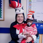 Franchise Owner dressed up as the Cat in the Hat smiling with a Primrose student on Read Across America Day