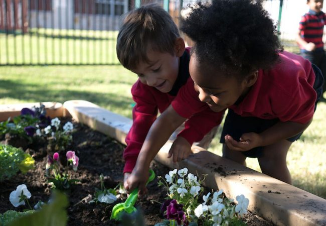 Primrose students playing in garden for Earth Day 2019