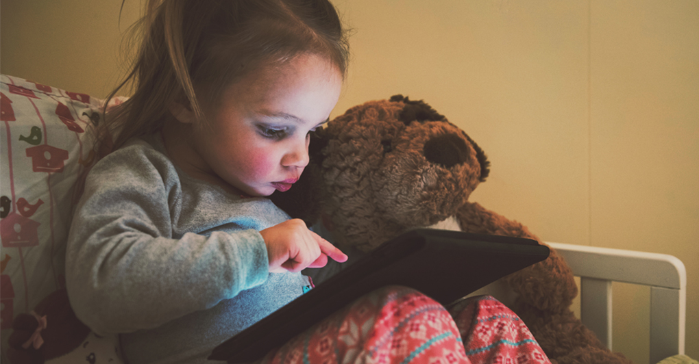 Child watches Kid's Youtube videos on tablet.