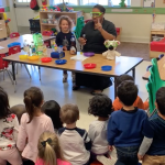Primrose teacher shows preschool students about science as they watch from their seats