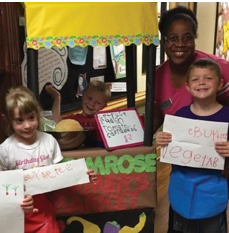 Students at Primrose School of Brassfield learn about math and gardening at their farmer's market