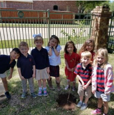 Primrose School students play in the garden on earth day