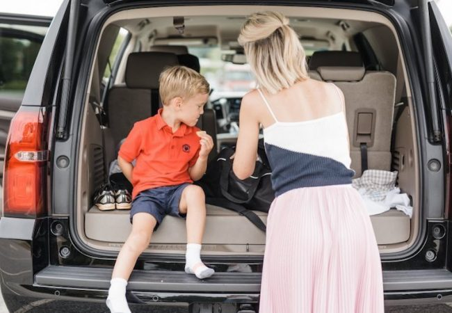 Primrose Schools mom with son after school in car
