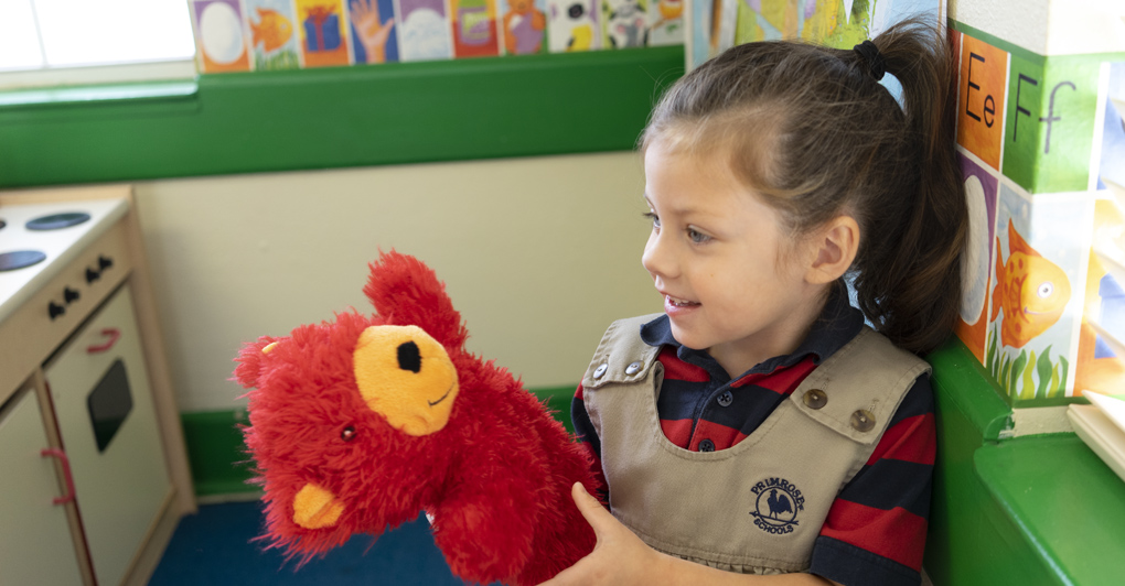 Primrose Student playing make believe with a puppet, primrose friend Benjamin