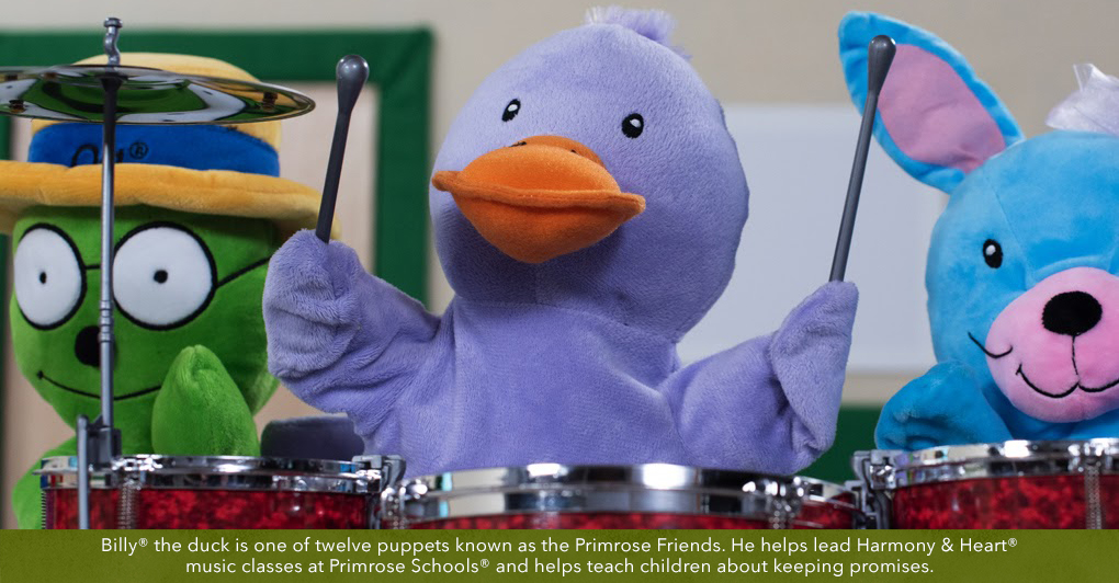 Primrose Puppet Billy playing the drum with friends